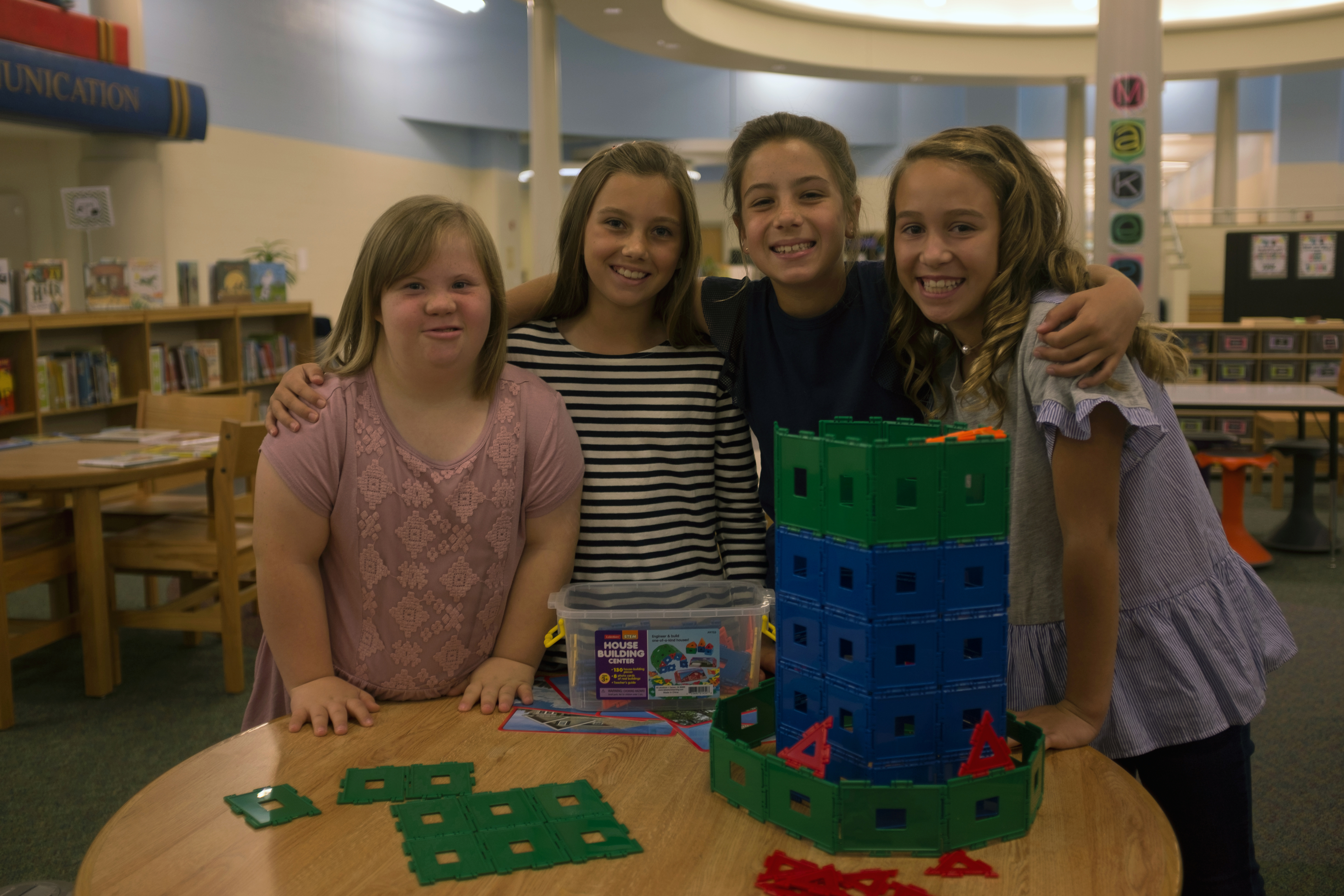 Girls at elementary school, including student with Down syndrome